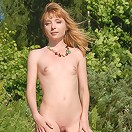 Naked girl at the pond
