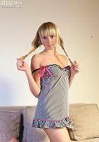 Leggy blonde teen poses.