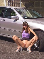 Angelina Stripping & Posing By a Car