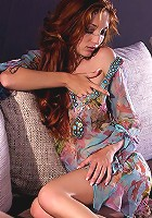 Long auburn tresses, turquoise blue eyes and topaz skin all add up to make Michelle a woman of striking appeal. Slender limbs and gracious curves capped with hard pink tips wrapped in sheer exotic flowers and lavender lace. Her hands vigorously rub and touch, exploring the curves and valleys of her form, setting nerves alight in their wandering. You can almost smell the spicy fragrance her aroused warm skin exudes. Beautifully sensual erotica, watch it and be set alight.