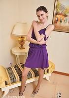 Sexy teen strips off her purple dress