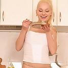 Sweet teen strips in her kitchen