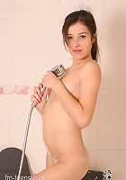 Join this petite teen in the shower