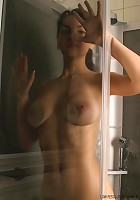 Teen with big tits enjoys soapy wet shower