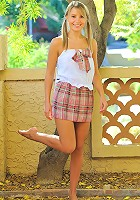 Blonde pigtail teen using four fingers