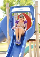 Danielle on the playground topless with a dildo in her pussy