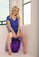 Glamorous Kara on a glass purple chair peels off her sheer blue top flaunting her teen body