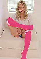 Sweet Kara in pink socks spreads and vibrates her precious pussy lips on the couch
