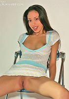 Sweet Alexis in her tight blue dress spreads her ass with a glass dildo