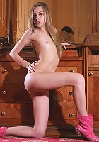 Flat chested teen Arina taking off all her pink lingerie and boots