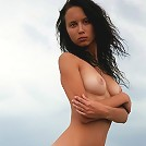 Sweet slim beauty posing absolutely naked
