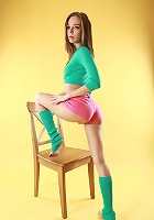 Skinny beautiful teen stripping completely sittinh on the chair