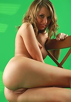 Perfectly shaped blonde teen posing naked on the chair
