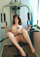 Awesome babe with piercing on her nipples is having sport exercises in the gym