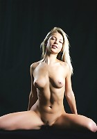 Adorable blonde with innocent appeal and youthful charm.