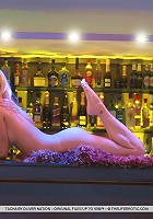 Nubile blonde in seductive and enticing poses.