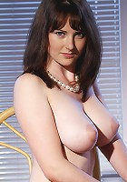 Sweet yet naughty debutante with voluptuous physique and large, scrumptious breasts.