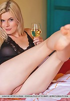 Sexy blond drink white wine and posing naked