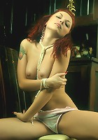 Redhead debutante in arousing and super seductive poses.