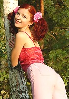 Red-haired teen in a forest
