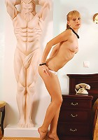 Sexy girl and a statue