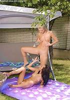 Devin and Sharon - Sunbathing cuties dildo poolside
