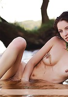 Zemani.com Rita - Beautiful brunet girl with hair pussy poses nude on the beach and on the water.